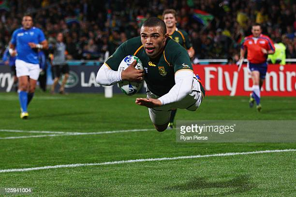 Bryan Habana of South Africa goes over to score their second try during the IRB 2011 Rugby World Cup Pool B match between South Africa and Namibia at...