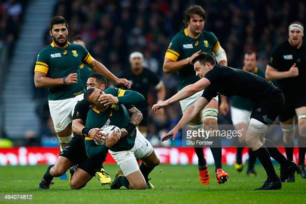 Bryan Habana of South Africa is tackled by Aaron Smith of the New Zealand All Blacks during the 2015 Rugby World Cup Semi Final match between South...
