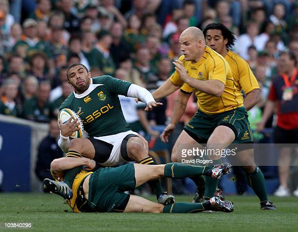 Bryan Habana of South Africa is tackled by Adam AshleyCooper and Stephen Moore during the 2010 TriNations match between the South African Springboks...