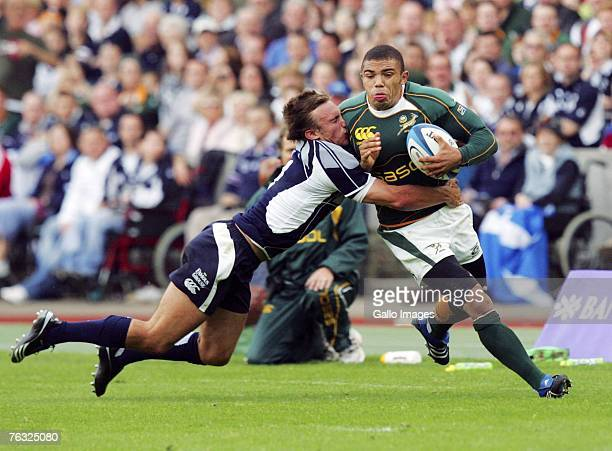 Bryan Habana of South Africa is tackled on the left wing during the Rugby Union International match between Scotland and South Africa at Murrayfield...