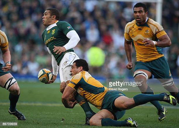 Bryan Habana of South Africa passes the ball as George Smith tackles during the Tri Nations match between the South Africa Springboks and the...
