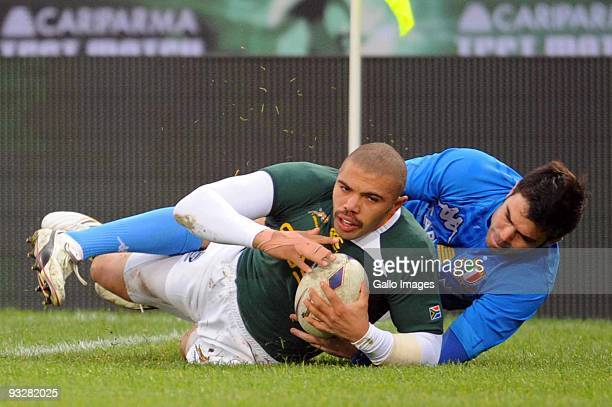 Bryan Habana of South Africa scores a try while being tackled by Craig Gower of Italy during the International match between Italy and South Africa...