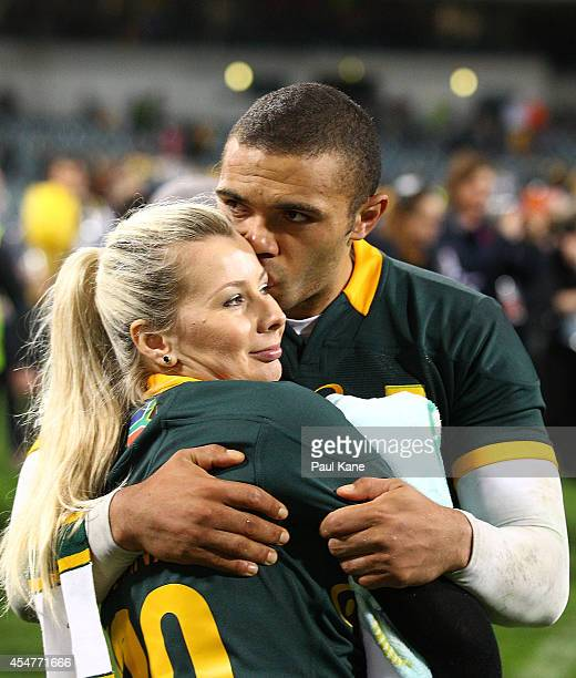 Bryan Habana of the Springboks hugs and kisses his wife Janine after playing his 100th Test during The Rugby Championship match between the...