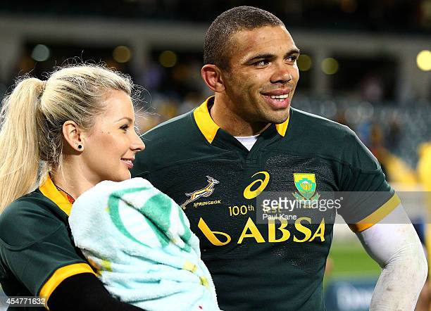 Bryan Habana of the Springboks looks on with his wife Janine and son Timothy after playing his 100th Test during The Rugby Championship match between...