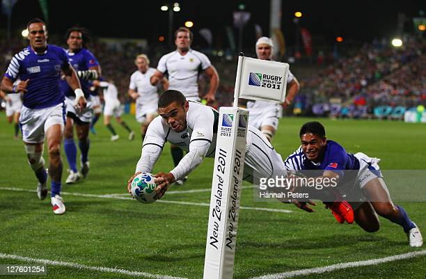 Bryan Habana of the Springboks of South Africa goes over ro score their first try during the IRB 2011 Rugby World Cup Pool D match between South...