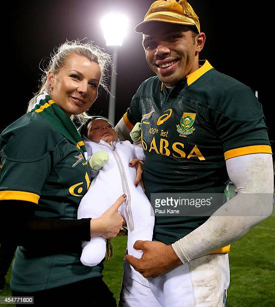 Bryan Habana of the Springboks poses with his wife Janine and son Timothy after being prsented with 100th Test cap at the conclusion of The Rugby...