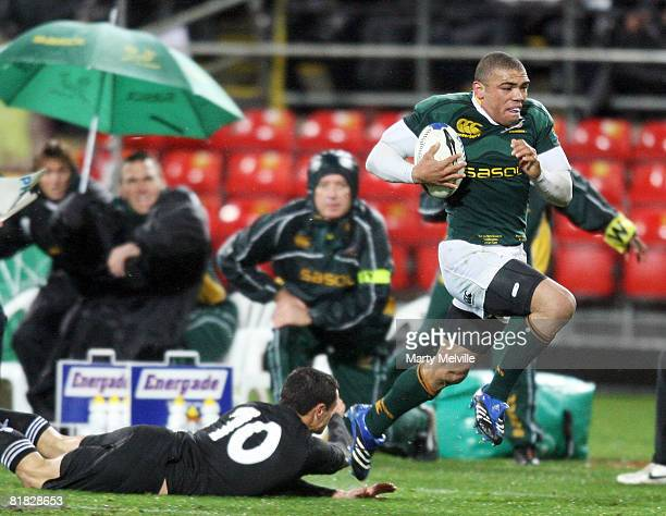 Bryan Habana of the Springboks runs out of a tackle by Dan Carter of the All Blacks during the 2008 Tri Nations series match between the New Zealand...