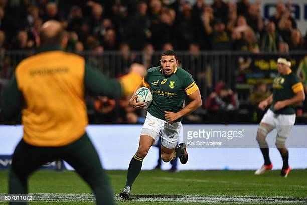 Bryan Habana of the Springboks runs through to score a try during the Rugby Championship match between the New Zealand All Blacks and the South...