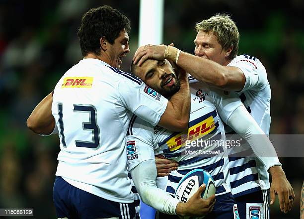 Bryan Habana of the Stormers is congratulated by teammates after crossing for a try during the round 16 Super Rugby match between the Rebels and the...