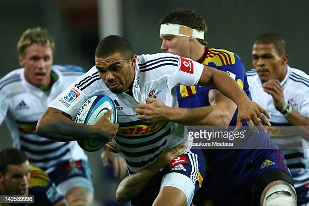 Bryan Habana of the Stormers is tackled during the Super Rugby round seven match between the Highlanders and the Stormers at Forsyth Barr Stadium on...