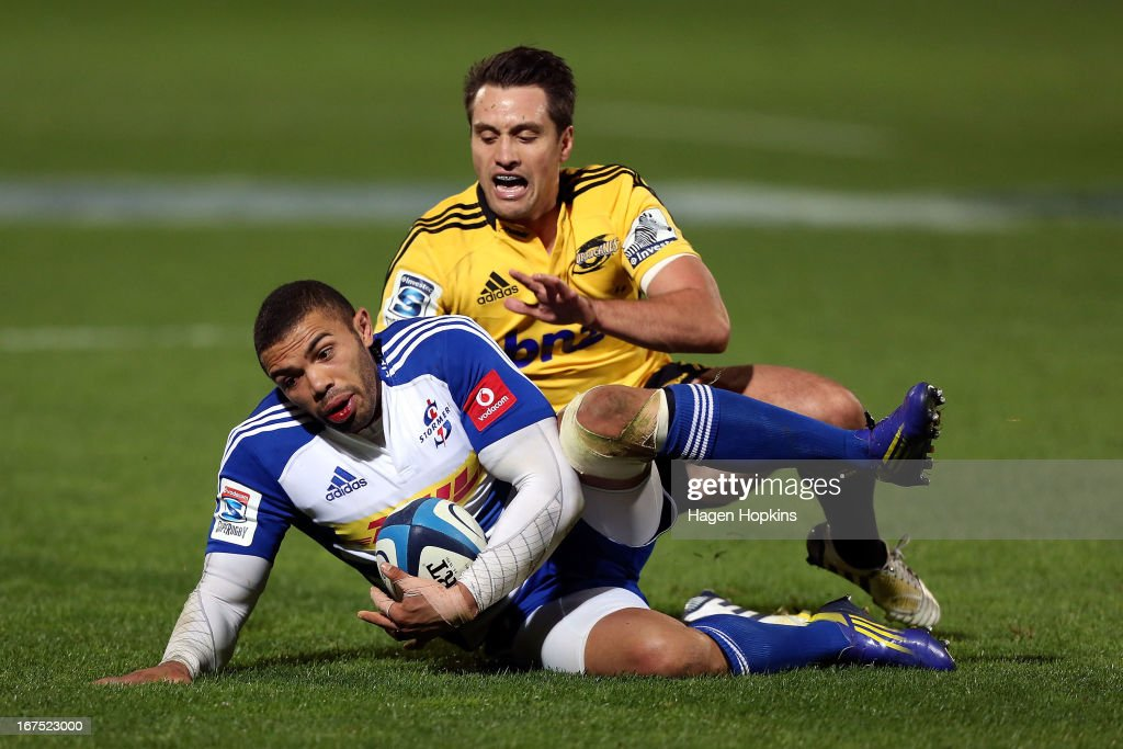 Bryan Habana of the Stormers secures a loose ball under pressure from Tim Bateman of the Hurricanes during the round 11 Super Rugby match between the Hurricanes and the Stormers at FMG Stadium on April 26, 2013 in Palmerston North, New Zealand.
