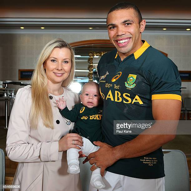Bryan Habana poses with his wife Janine and son Timothy before the South Africa Springboks captain's run at the Duxton Hotel on September 5 2014 in...