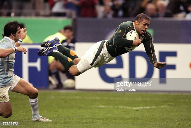 Bryan Habana scores a try with Horacio Agulla too late to stop him during the Rugby World Cup Semi Final between South Africa and Argentina at the...