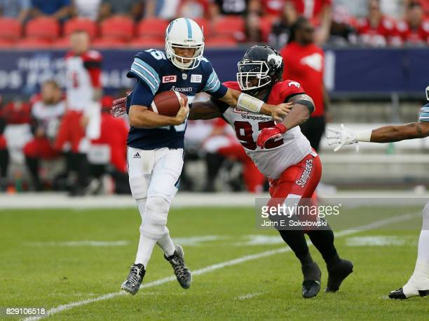 Bryan Hall of the Calgary Stampeders goes to sack Ricky Ray of the Toronto Argonauts during a CFL game at BMO Field on August 3 2017 in Toronto...