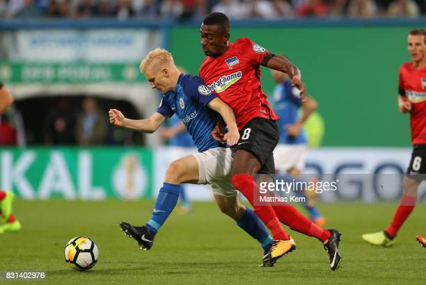 Bryan Henning of Rostock battles for the ball with Salomon Kalou of Berlin during the DFB Cup first round match between FC Hansa Rostock and Hertha...