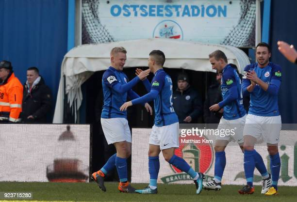 Bryan Henning of Rostock jubilates with team mates after scoring the first goal during the 3Liga match between FC Hansa Rostock and 1 FC Magdeburg at...