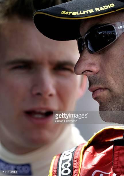 Bryan Herta driver of the Andretti Green Racing XM Satellite Radio Honda Dallara with his teammate Dan Wheldon during practice for the Indy Racing...