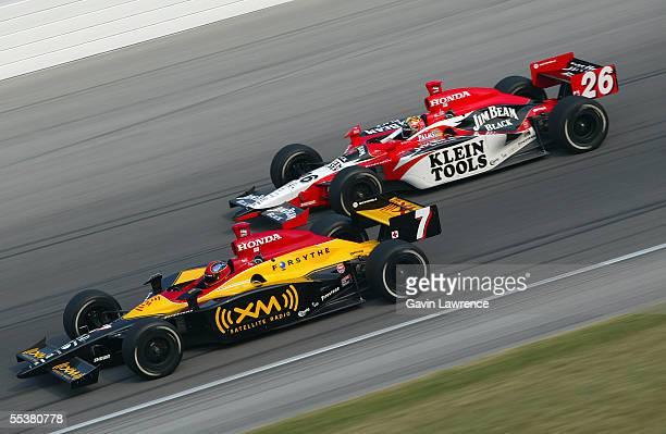 Bryan Herta driver of the XM Satellite Andretti Green Racing Dallara Honda leads Dan Wheldon driver of the Klein Tools/Jim Beam Andretti Green Racing...