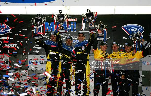 Bryan Herta Tony Kanaan and Dario Franchitti drivers of the Andretti Green Racing Acura ARX01celebrate winning the LMP2 Class with third placed...