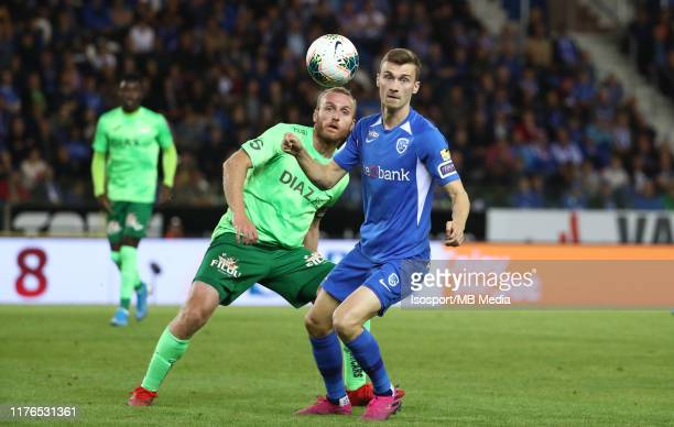 Bryan Heynen of Krc Genk battles for the ball with Kevin Vandendriessche of Kv Oostende during the Jupiler Pro League match between KRC Genk and KV...
