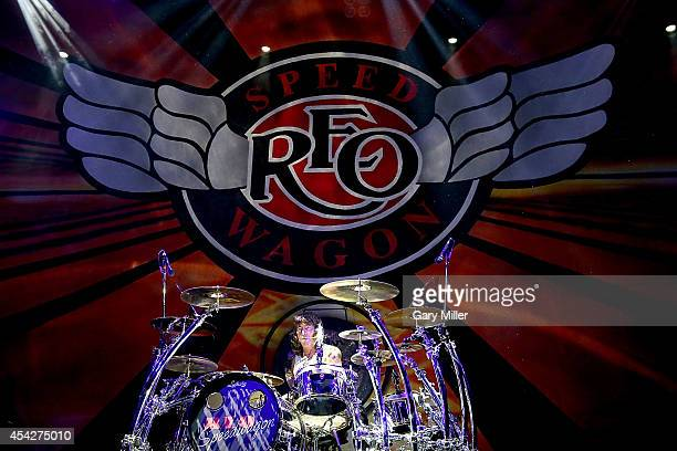 Bryan Hitt performs in concert with REO Speedwagon at the Cedar Park Center on August 27 2014 in Cedar Park Texas