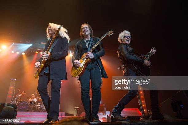 Bryan HittBruce HallDave Amato and Kevin Cronin of REO Speedwagon performs in concert at Emens Auditorium Ball State University on February 7 2014 in...