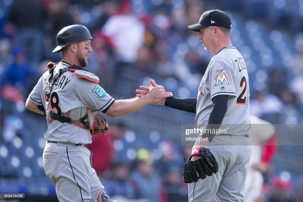 Bryan Holaday #28 and Brad Ziegler #29 of the Miami Marlins celebrate after the game against the Philadelphia Phillies at Citizens Bank Park on April 8, 2018 in Philadelphia, Pennsylvania. The Marlins defeated the Phillies 6-3.