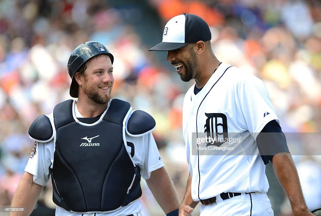 Bryan Holaday #50 and David Price #14 of the Detroit Tigers talk during the Spring Training game against the New York Mets at Joker Marchant Stadium on March 21, 2015 in Lakeland, Florida. The Tigers defeated the Mets 6-4.