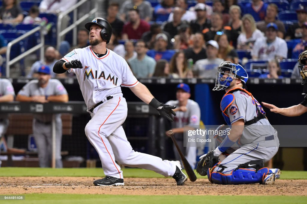 Bryan Holaday #28 of the Miami Marlins hits a double during the eighth inning against the New York Mets at Marlins Park on April 10, 2018 in Miami, Florida.