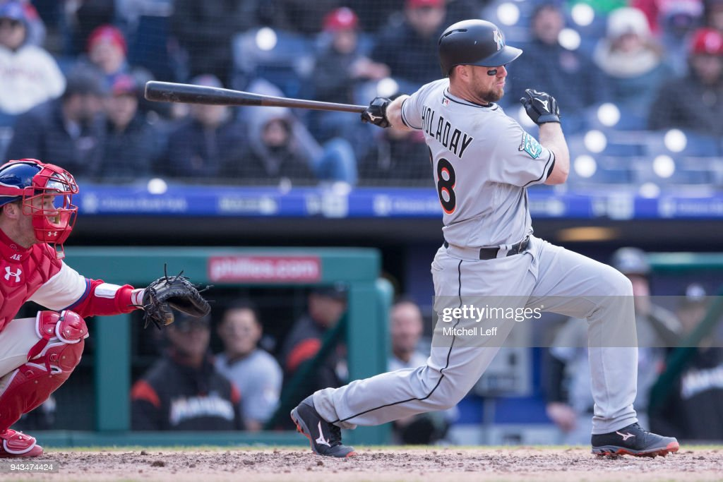 Bryan Holaday #28 of the Miami Marlins hits an RBI single in the top of the eighth inning against the Philadelphia Phillies at Citizens Bank Park on April 8, 2018 in Philadelphia, Pennsylvania. The Marlins defeated the Phillies 6-3.