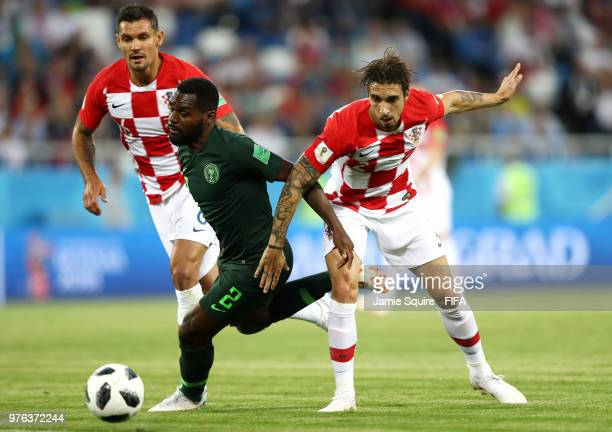Bryan Idowu of Nigeria is challenged by Sime Vrsaljko of Croatia during the 2018 FIFA World Cup Russia group D match between Croatia and Nigeria at...