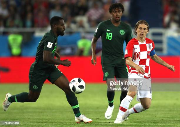 Bryan Idowu of Nigeria runs with the ball under pressure from Luka Modric of Croatia during the 2018 FIFA World Cup Russia group D match between...