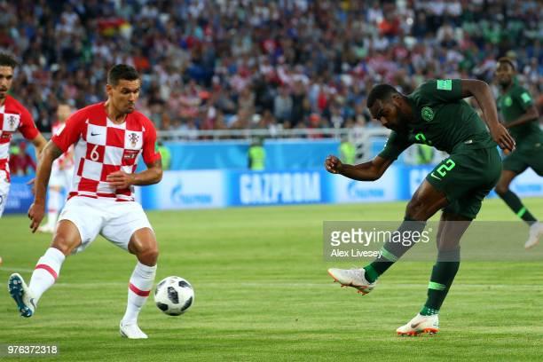 Bryan Idowu of Nigeria shoots past Dejan Lovren of Croatia during the 2018 FIFA World Cup Russia group D match between Croatia and Nigeria at...