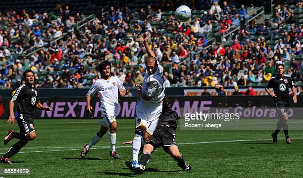 Bryan Jordan of the Los Angeles Galaxy fights for the ball with Dejan Jakovic of DC United the Home Depot Center on March 22 2009 in Carson California