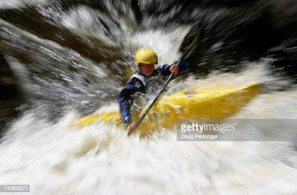 Bryan Kirk of Charlottesville, Virginia heads down the course during the Steep Creek Kayaking Championship on Homestake Creek at the Teva Mountain...