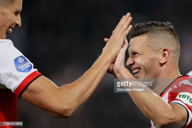 Bryan Linssen of Feyenoord celebrates 2-0 with Guus Til of Feyenoord during the Dutch Eredivisie match between Feyenoord v SC Heerenveen at the...
