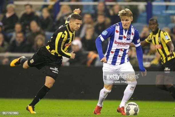 Bryan Linssen of Vitesse Martin Odegaard of SC Heerenveen during the Dutch Eredivisie match between Vitesse v SC Heerenveen at the GelreDome on...