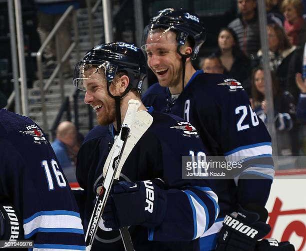 Bryan Little and Blake Wheeler of the Winnipeg Jets are all smiles as they celebrate a 52 victory over the New York Rangers at the MTS Centre on...