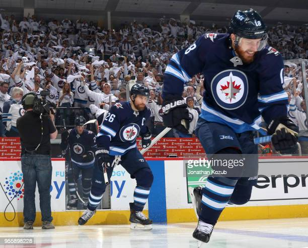 Bryan Little and Blake Wheeler of the Winnipeg Jets hit the ice prior to puck drop against the Nashville Predators in Game Four of the Western...