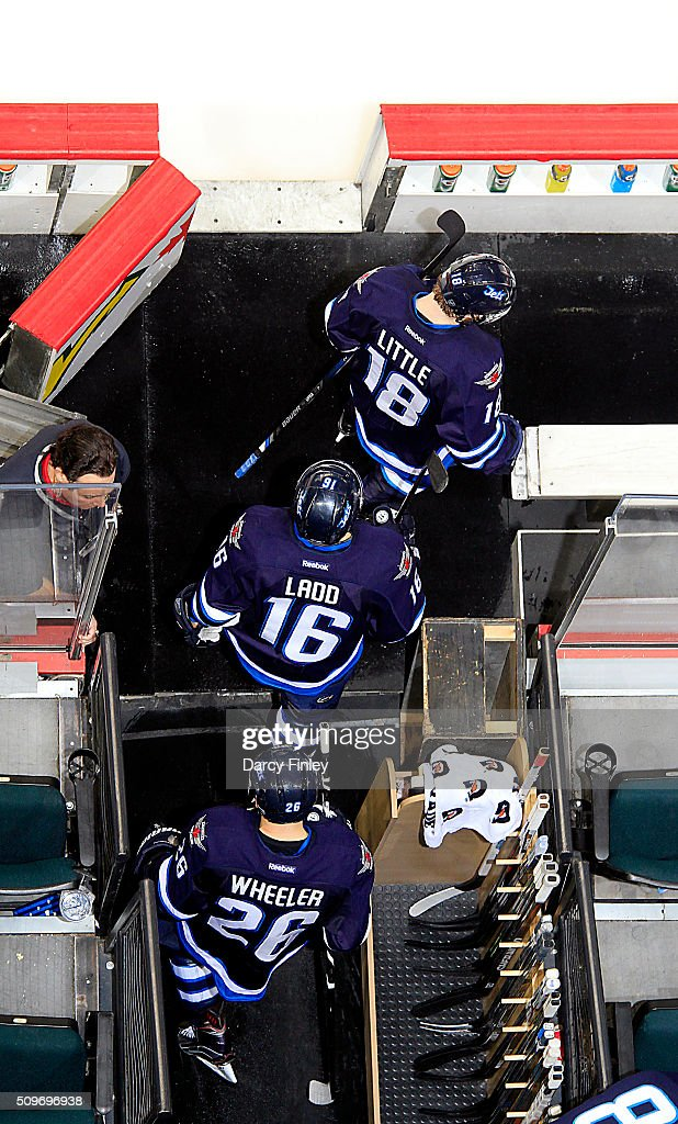 Bryan Little #18, Andrew Ladd #16 and Blake Wheeler #26 of the Winnipeg Jets head to the ice for the start of third period action against the Boston Bruins at the MTS Centre on February 11, 2016 in Winnipeg, Manitoba, Canada.