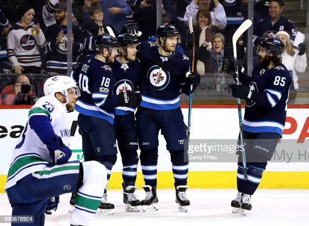 Bryan Little Nikolaj Ehlers Joel Armia and Mathieu Perreault of the Winnipeg Jets celebrate a second period goal against the Vancouver Canucks at the...