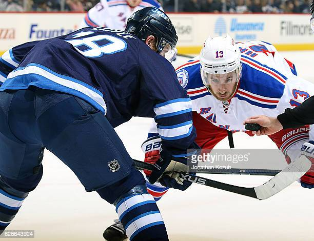 Bryan Little of the Winnipeg Jets and Kevin Hayes of the New York Rangers get set for a first period faceoff at the MTS Centre on December 8 2016 in...