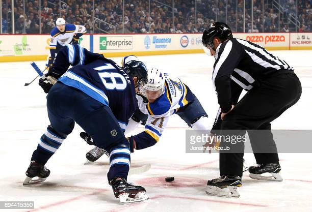 Bryan Little of the Winnipeg Jets and Vladimir Sobotka of the St Louis Blues take a first period faceoff at the Bell MTS Place on December 17 2017 in...