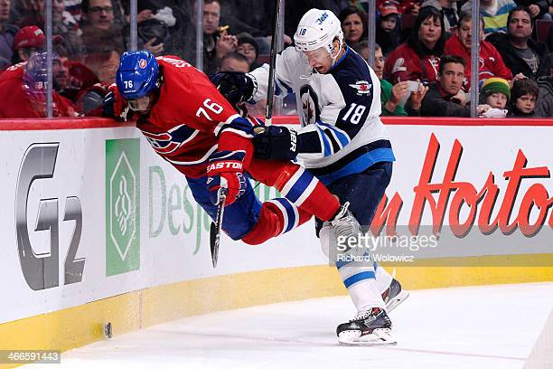 Bryan Little of the Winnipeg Jets body checks PK Subban of the Montreal Canadiens during the NHL game at the Bell Centre on February 2 2014 in...
