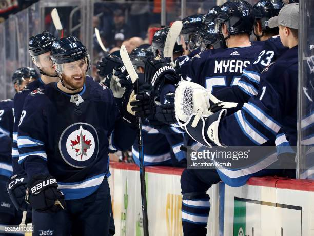 Bryan Little of the Winnipeg Jets celebrates his first period goal against the Chicago Blackhawks with teammates at the bench at the Bell MTS Place...