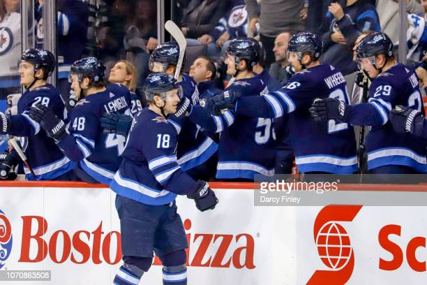 Bryan Little of the Winnipeg Jets celebrates his third period goal against the Philadelphia Flyers with teammates at the bench at the Bell MTS Place...