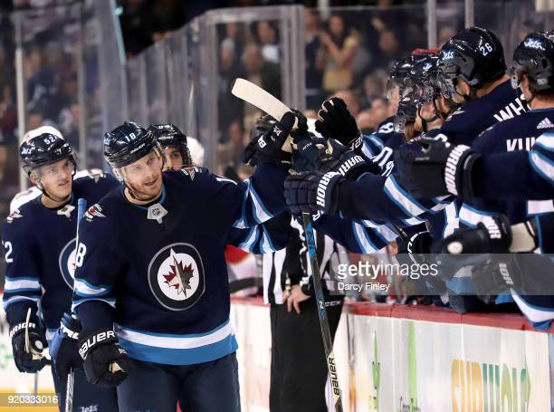 Bryan Little of the Winnipeg Jets celebrates his third period goal against the Florida Panthers with teammates at the bench at the Bell MTS Place on...