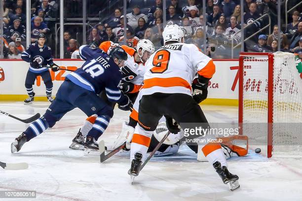 Bryan Little of the Winnipeg Jets deflects the puck behind goaltender Anthony Stolarz of the Philadelphia Flyers for a third period goal at the Bell...