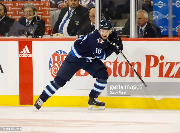 Bryan Little of the Winnipeg Jets follows the play down the ice during third period action against the St Louis Blues at the Bell MTS Place on...