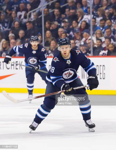 Bryan Little of the Winnipeg Jets follows the play down the ice during first period action against the San Jose Sharks at the Bell MTS Place on March...